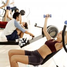 People Exercising at a Gymnasium
