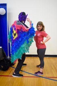 Eta Sigma Gamma member Amber Dellich poses with a 2016 condom design challenge participant and his design.